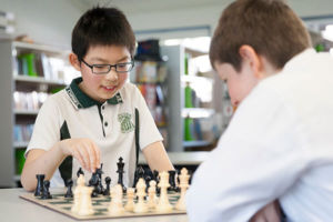 Students playing chess at St Peter Chanel Catholic Primary School Regents Park