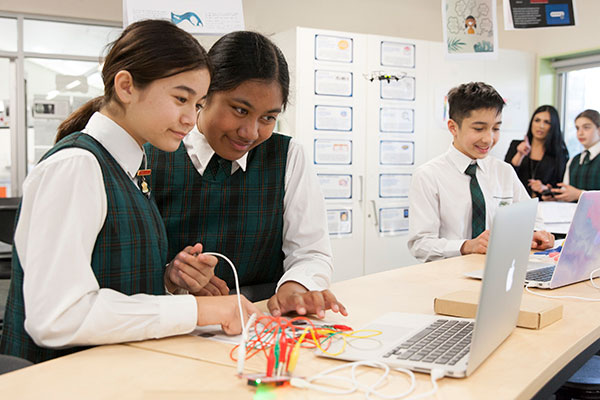 Students doing coding inside a classroom at St Peter Chanel Catholic Primary School Regents Park