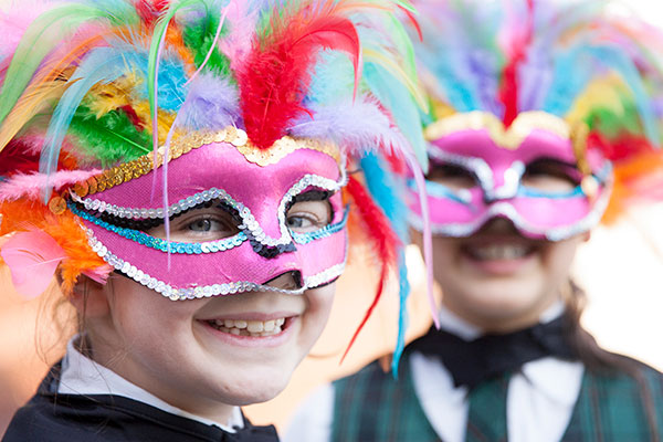 Two students at St Peter Chanel Catholic Primary School Regents Park dressed up in costume for a performance