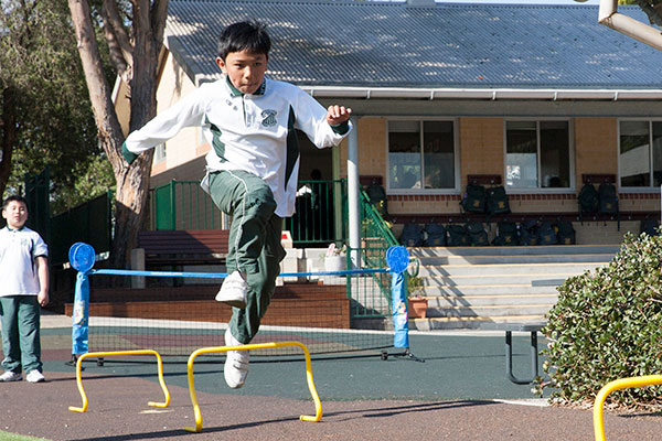 Students at St Peter Chanel Catholic Primary School Regents Park practicing athletics