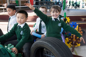 Students enjoying imaginative play on the playground at St Peter Chanel Catholic Primary School Regents Park