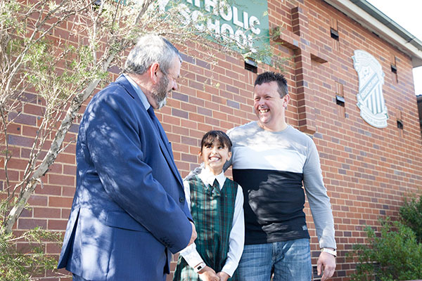 Parent and student talking to the principal at St Peter Chanel Catholic Primary School Regents Park