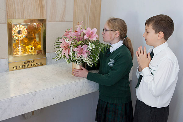 St Peter Chanel Catholic Primary School Regents Park students praying in front of the Relic of St Peter Chanel