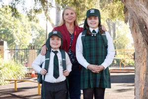 Mother and her two children at St Peter Chanel Catholic Primary School Regents Park
